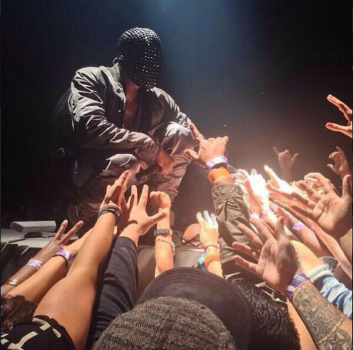 Kanye engages with the crowd on the Yeezus tour
