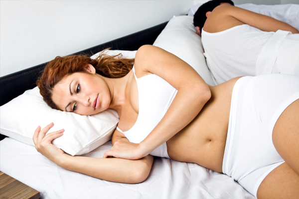 couple in bed after sex