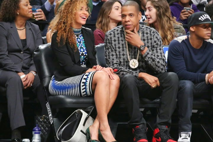 Jay Z with wife Beyonce Knowles sporting a Five Percenter medallion rockets nets basketball