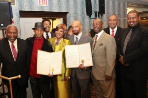 Charles and Randy Fisher receive a Resolution from the NYS Assembly and Senate at Guy R. Brewer United Democratic Club. L to R: District Leader Archie Spigner, C. Fisher, Assemblyman Bill Scarborough, District Leader Leslie Spigner, R. Fisher, Fred Simmons representing Senator Smith, Manny Caughman, and Leroy Gadsden (Jamaica NAACP).  Photo by Larry Moore.