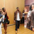 Tika Sumpter and Chadwick Boseman In Front Of GET ON UP Exhibit