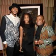 Carmelo Anthony singer Kelly Rowland and artist Kehinde Wiley at Carmelo Anthony Kehinde Wiley Dinner Hosted by GREY GOOSE