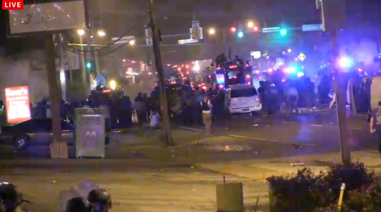 SUnday night ferguson escalated level tear gas gunfire
