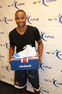 Jay Ellis chillin with his new kicks.