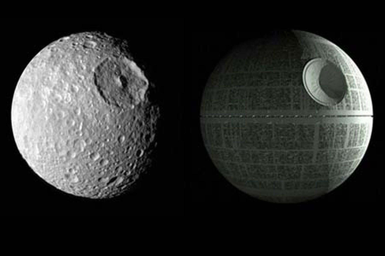 The real death star moon Mimas in orbit around Saturn : space