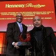 Rodney Williams, SVP of Moet Hennessy USA presents Daymond with the Hennessy Privilege VSOP Award.