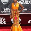 The power woman in Power Naturi Naughton fabulously glowing wearing a dress to channel her natural roots. I say save it for another time, the queen in you deserves summer glam!