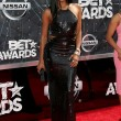 The beautiful Gabrielle Union in an all black bedazzled sleek gown. For this outfit I say the cut outs what make her to the cut.
