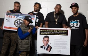 """Sharieff """"The Fitness Sheriff,"""" R. Fisher, DJ Self and his son and C. Fisher holding Presidential Message from Obama and the HAGGV Banner."""