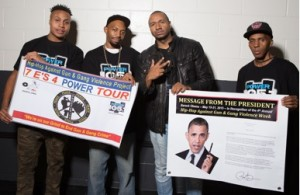 "Sharieff ""The Fitness Sheriff,"" R. Fisher, DJ Suss-One and C. Fisher holding Presidential Message from Obama and the HAGGV Banner.​"