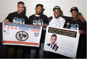 """Sharieff """"The Fitness Sheriff,"""" R. Fisher, Em Ez and C. Fisher holding Presidential Message from Obama and the HAGGV Banner."""