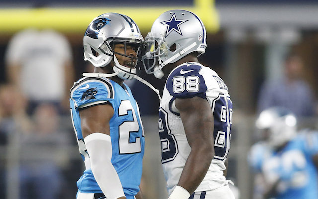 Nov 26, 2015; Arlington, TX, USA; Carolina Panthers cornerback Josh Norman (24) talks with Dallas Cowboys wide receiver Dez Bryant (88) after an interception during the first quarter of a NFL game on Thanksgiving at AT&T Stadium. Mandatory Credit: Tim Heitman-USA TODAY Sports