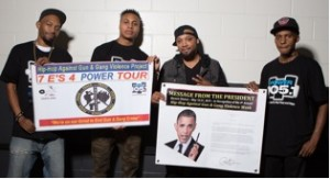 "R. Fisher, Sharieff ""The Fitness Sheriff,"" Jovonn and C. Fisher holding Presidential Message from Obama and the HAGGV Banner.​"