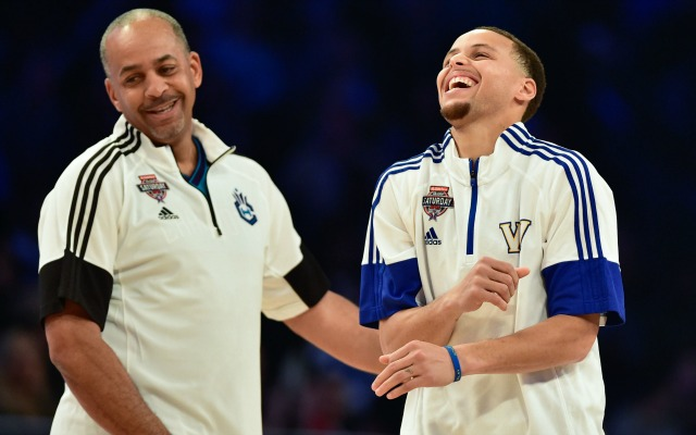 Feb 14, 2015; New York, NY, USA; Team Curry legend Dell Curry (left) and Team Curry guard Stephen Curry of the Golden State Warriors (30, right) celebrate during the 2015 NBA All Star Shooting Stars competition at Barclays Center. Mandatory Credit: Bob Donnan-USA TODAY Sports