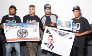 """R. Fisher, Sharieff """"The Fitness Sheriff,"""" DJ Whutever and C. Fisher holding Presidential Message from Obama and the HAGGV Banner."""