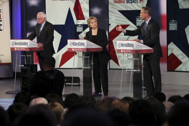 From right: Martin O'Malley, Hillary Rodham Clinton and Sen. Bernie Sanders take part in the Democratic presidential debate at Drake University in Des Moines, Iowa, Nov. 14, 2015. (Ruth Fremson/The New York Times)