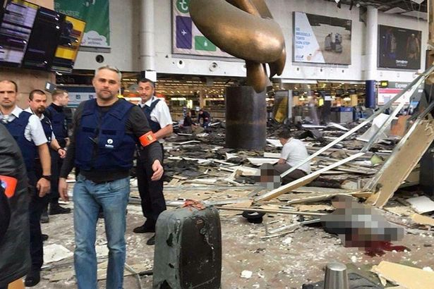PAY Emergency services inside Brussels Airport following an explosion