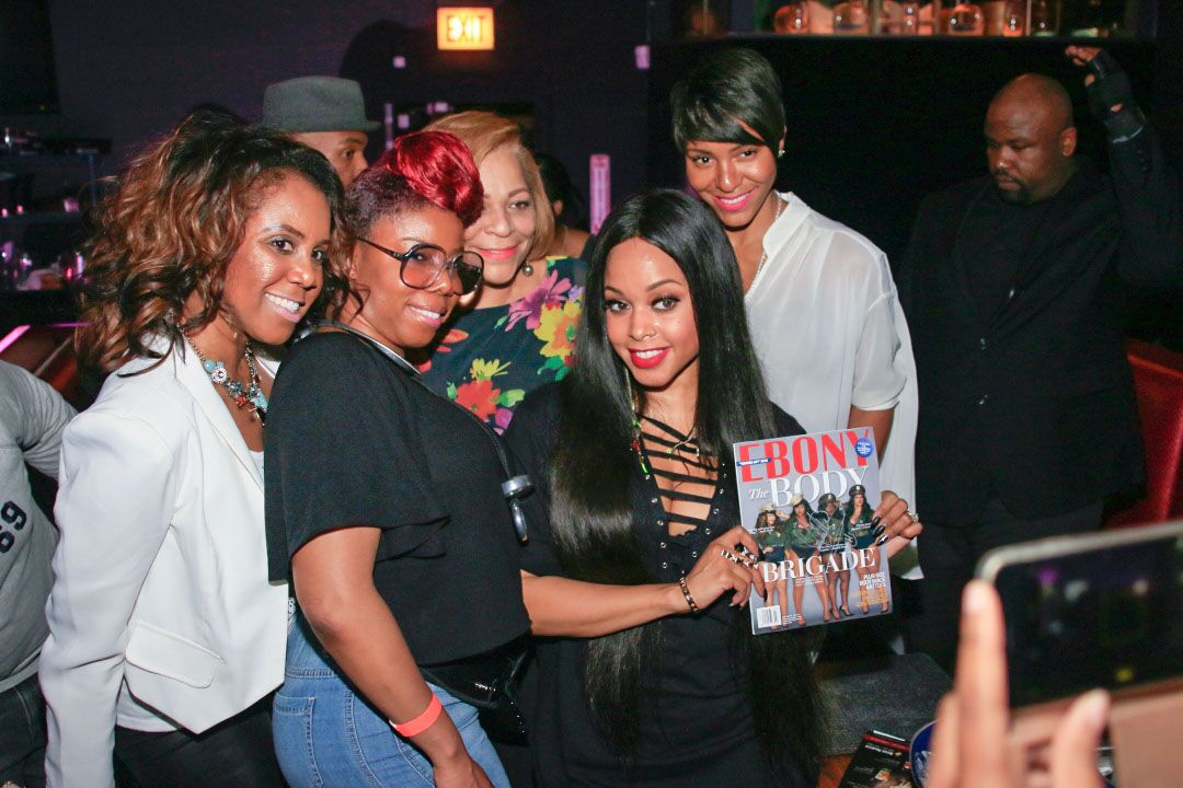chrisette-with-fans-source