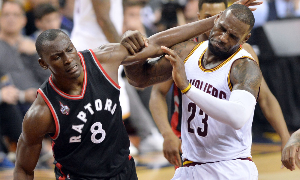 May 17, 2016; Cleveland, OH, USA; Cleveland Cavaliers forward LeBron James (23) gets tangled up with Toronto Raptors center Bismack Biyombo (8) during the third quarter in game one of the Eastern conference finals of the NBA Playoffs at Quicken Loans Arena. The Cavs won 115-84. Mandatory Credit: Ken Blaze-USA TODAY Sports ORG XMIT: USATSI-269268 ORIG FILE ID:  20160517_pjc_bk4_259.JPG