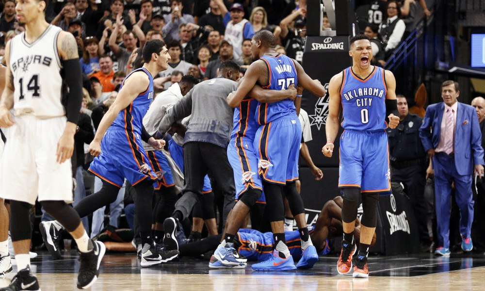 May 2, 2016; San Antonio, TX, USA; Oklahoma City Thunder point guard Russell Westbrook (0), and small forward Kevin Durant (35), and teammates celebrate a victory over the San Antonio Spurs in game two of the second round of the NBA Playoffs at AT&T Center. Mandatory Credit: Soobum Im-USA TODAY Sports