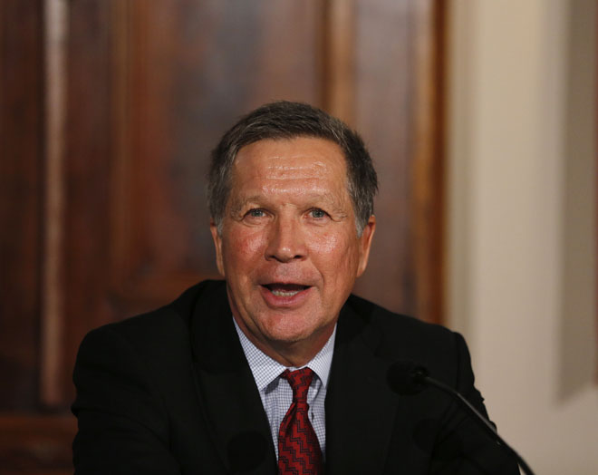 Governor John Kasich speaks while announcing a new task force to improve community-police relations from the Lincoln Room in the Statehouse on Friday, December 5, 2014. (Columbus Dispatch photo by Jonathan Quilter)
