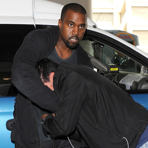 51158457 Rapper Kanye West tussles with a photographer at LAX airport in Los Angeles, California after arriving on a flight on July 19, 2013. It's being reported that Kanye got mad after the photog pictured was probing the rapper with too many questions! FameFlynet, Inc - Beverly Hills, CA, USA - +1 (818) 307-4813