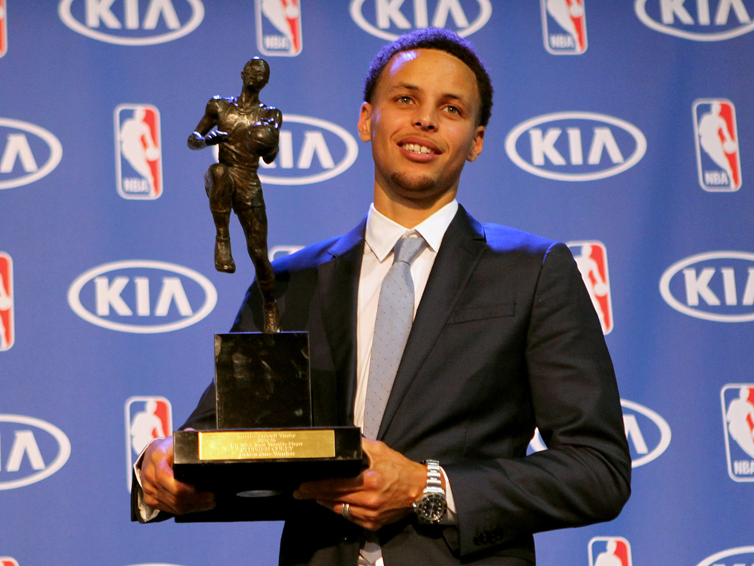 Golden State Warriors guard Stephen Curry accepts the NBA KIA Most Valuable Player for the 2014-2015 Season at the Warriors Training Facility in Oakland, Calif., on Monday, May 2, 2015.
