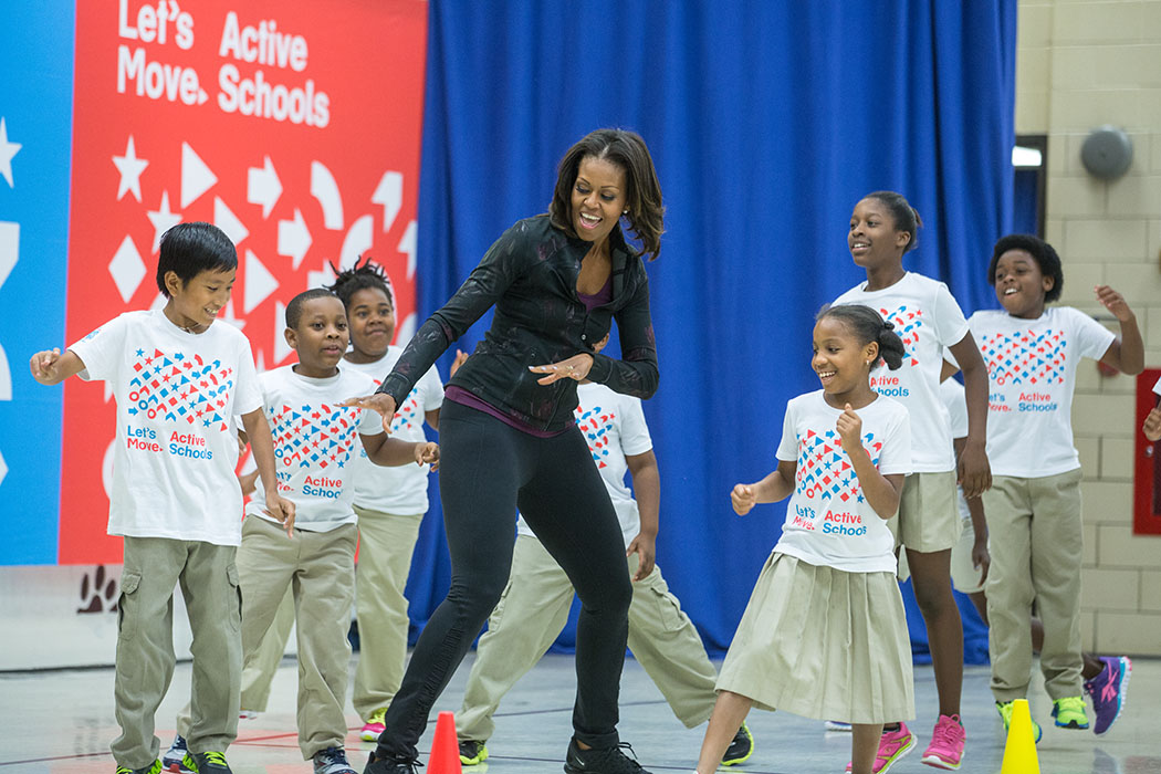 "First Lady Michelle Obama participates in a musical run and musical hoops activity with students during a back to school ""Let's Move! Active Schools"" event at Orr Elementary School in Washington, D.C., Sept. 6, 2013. (Official White House Photo by Chuck Kennedy)"