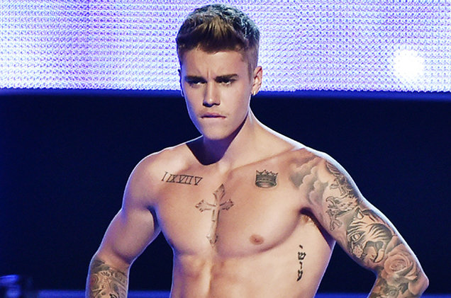 justin bieber shirtless presents onstage at fashion rocks  billboard