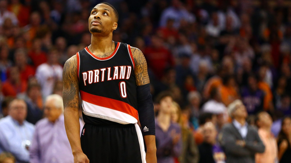 Jan 21, 2015; Phoenix, AZ, USA; Portland Trail Blazers guard Damian Lillard (0) reacts in the fourth quarter against the Phoenix Suns at US Airways Center. The Suns defeated the Blazers 118-113. Mandatory Credit: Mark J. Rebilas-USA TODAY Sports
