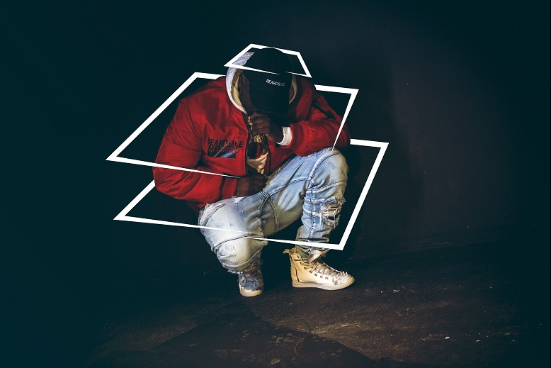 Zoey Dollaz Red Jacket crouching with KRUZIN footwear crazy horse white