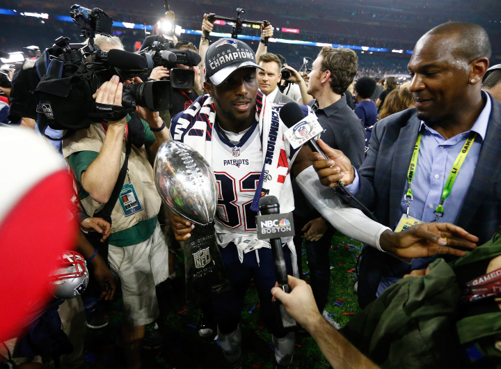 epa05774250 New England Patriots free safety Devin McCourty holds the Vince Lombardi Trophy on the field after the New England Patriots defeated the Atlanta Falcons in Super Bowl LI at NRG Stadium in Houston, Texas, USA, 05 February 2017.  EPA/LARRY W. SMITH