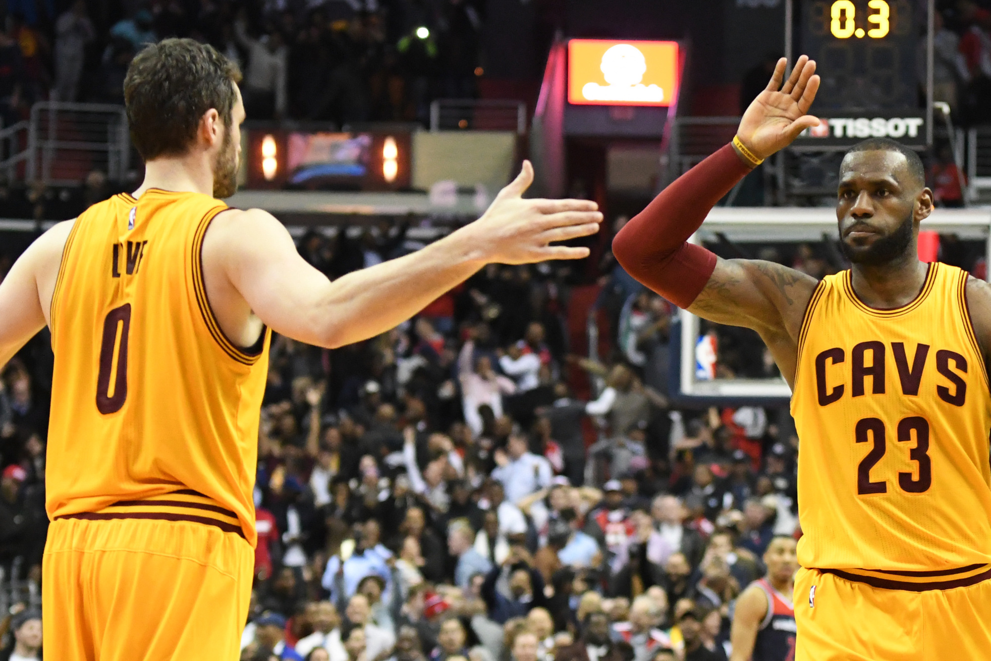 Feb 6, 2017; Washington, DC, USA; Cleveland Cavaliers forward LeBron James (23) high fives forward Kevin Love (0) after making a game tying three point shot during the fourth quarter against the Washington Wizards  at Verizon Center. Cleveland Cavaliers defeated Washington Wizards 140-135 in fourth quarter. Mandatory Credit: Tommy Gilligan-USA TODAY Sports