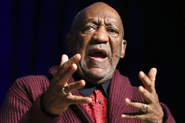 Comedian Bill Cosby performs at the Stand Up for Heroes event at Madison Square Garden, Wednesday, Nov. 6, 2013, in New York. (John Minchillo/Invision/AP)