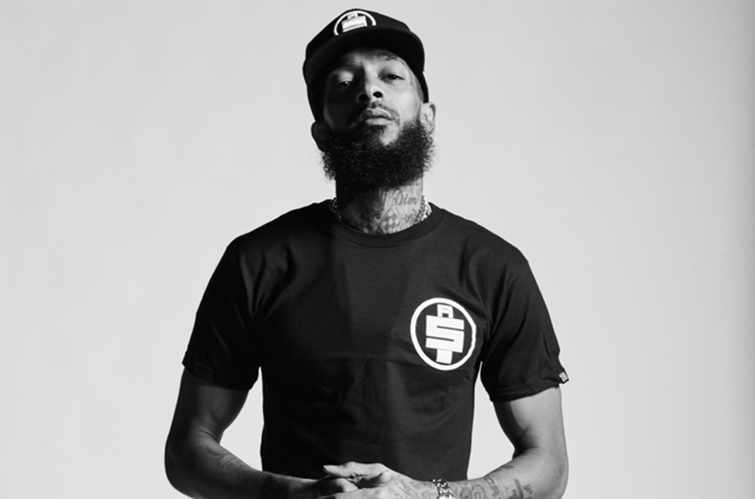 Nipsey Hussle press photo  a a billboard