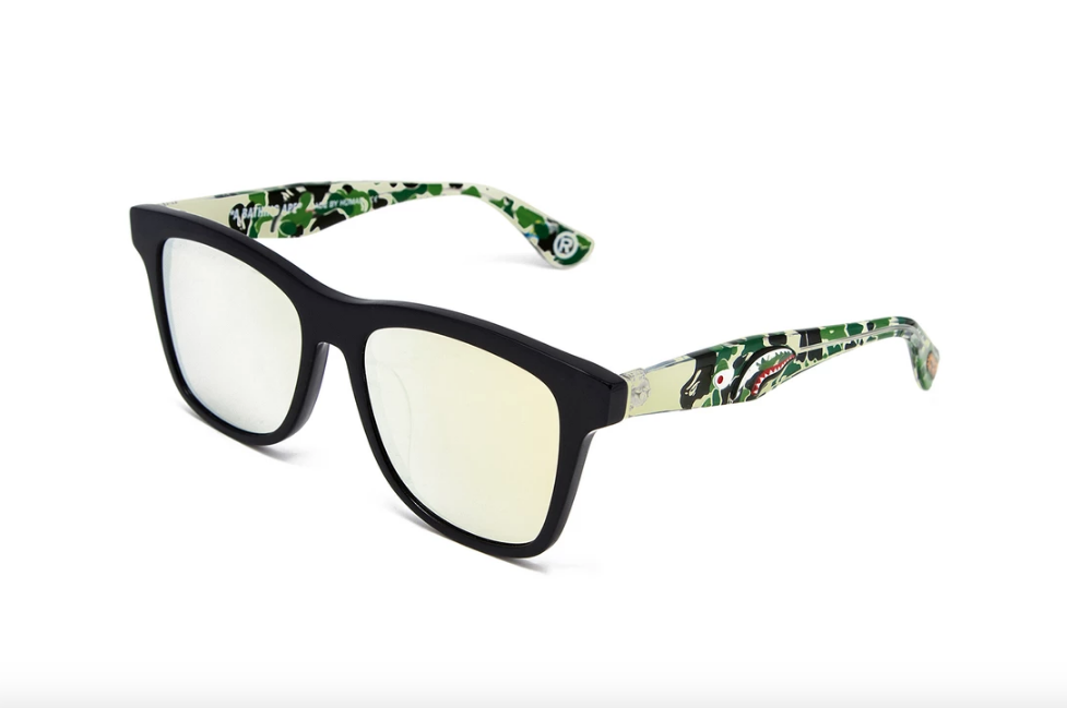 "51cf4c16e3b The new ""Dad and Son Sunglasses"" pack comes with two pairs of specs  designed with the classic BAPE camo print. You won t even have to argue  over who gets ..."