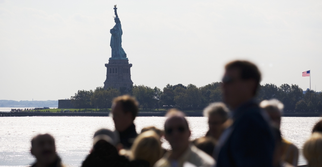 people on boat near statue of liberty P
