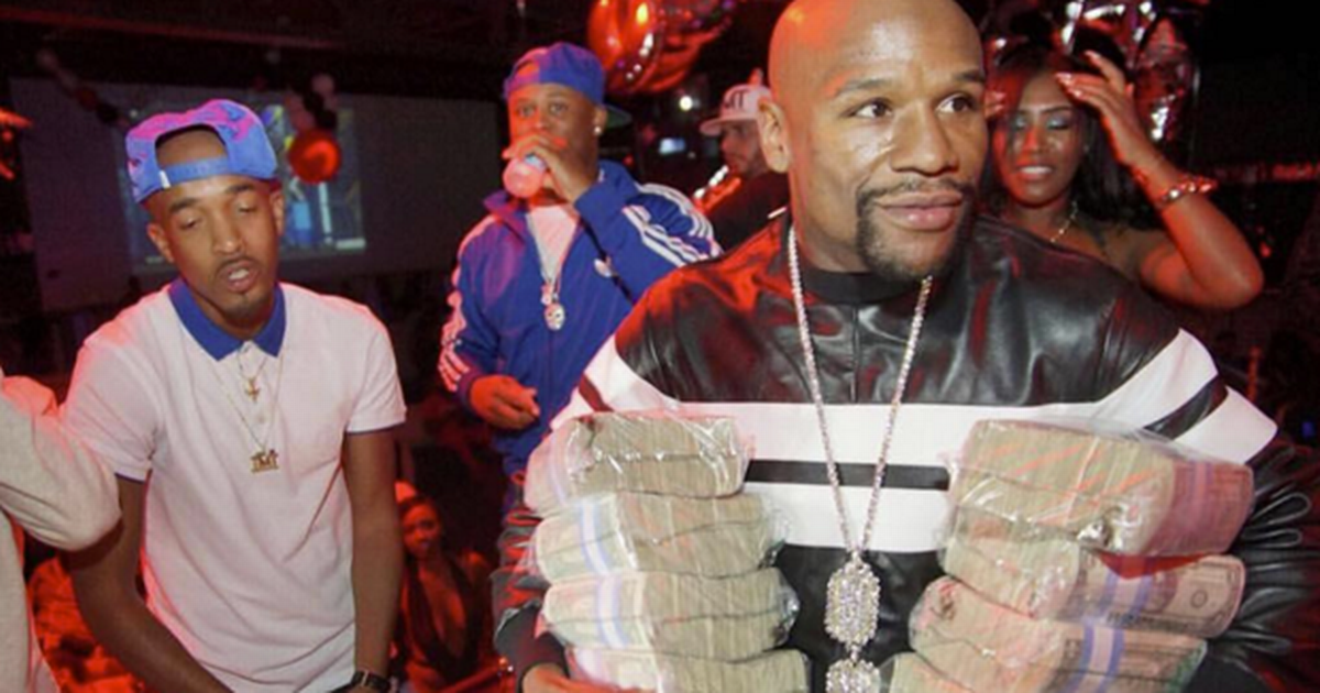 Floyd Mayweather walks out of the bank with large sum of money