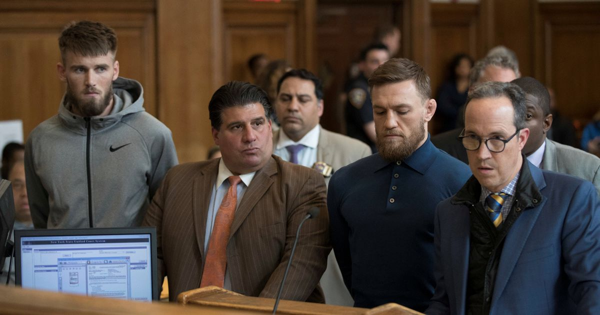 Mixed martial arts fighter Conor McGregor and Cian Cowley during their arraignment in a New York Cit