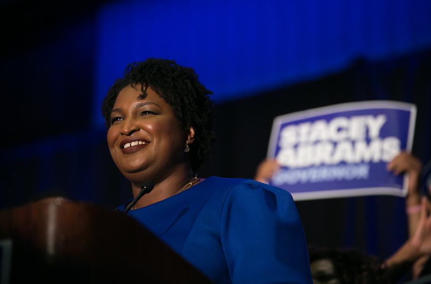 Stacey Abrams Defends 1992 Flag Burning Protest