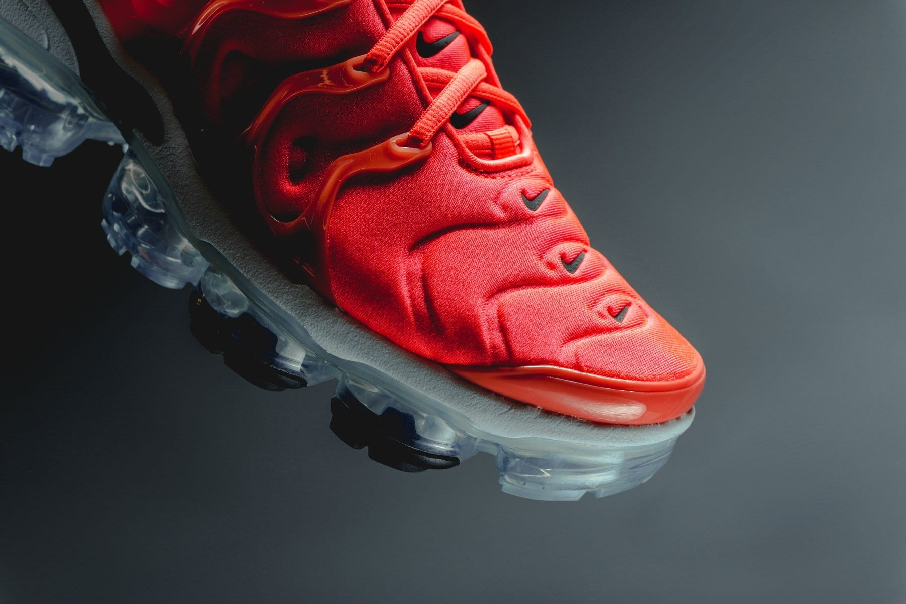 """4e1a4a711a9cb Pick up the Nike Air VaporMax Plus """"Bright Crimson Black"""" right now for   190 USD in the Swoosh s web store and via select retailers"""