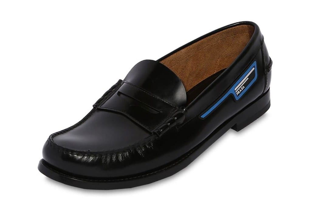 da05e4e858a Cop these all-black Prada Penny Loafers right now for  690 USD at select  retailers
