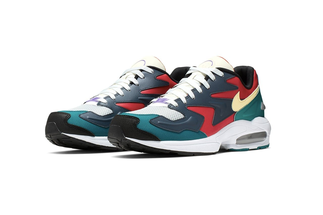 "701232b8ad15a Arriving in ""Habanero Red/Armory Navy"" and ""Dark Obsidian/Sail,"" the new  Air Max 2 Light hues add the perfect touch of style to a shoe that already  gives ..."