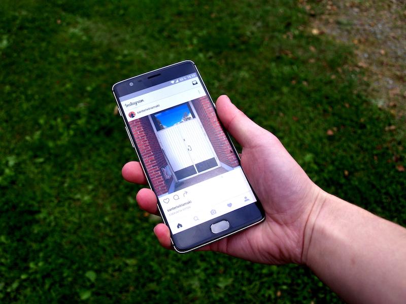Instagram app on smartphone grass background