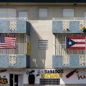 px US and Puerto Rico flags on a building in Puerto Rico e