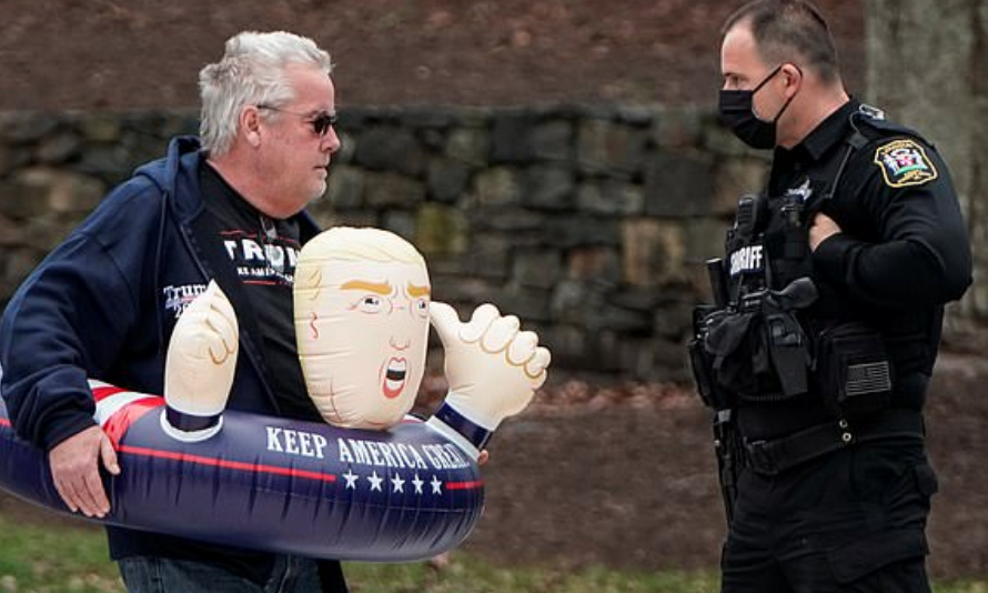 Trump Supporter Charged For Coughing On Protestor At POTUS' Virginia Golf Course
