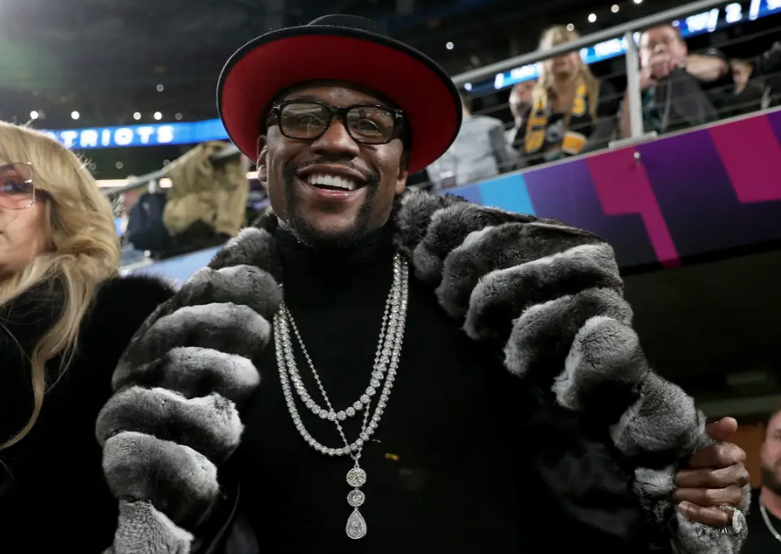 [WATCH] Floyd Mayweather Receives $15K Kobe/LeBron Topps Trading Card As Birthday Gift
