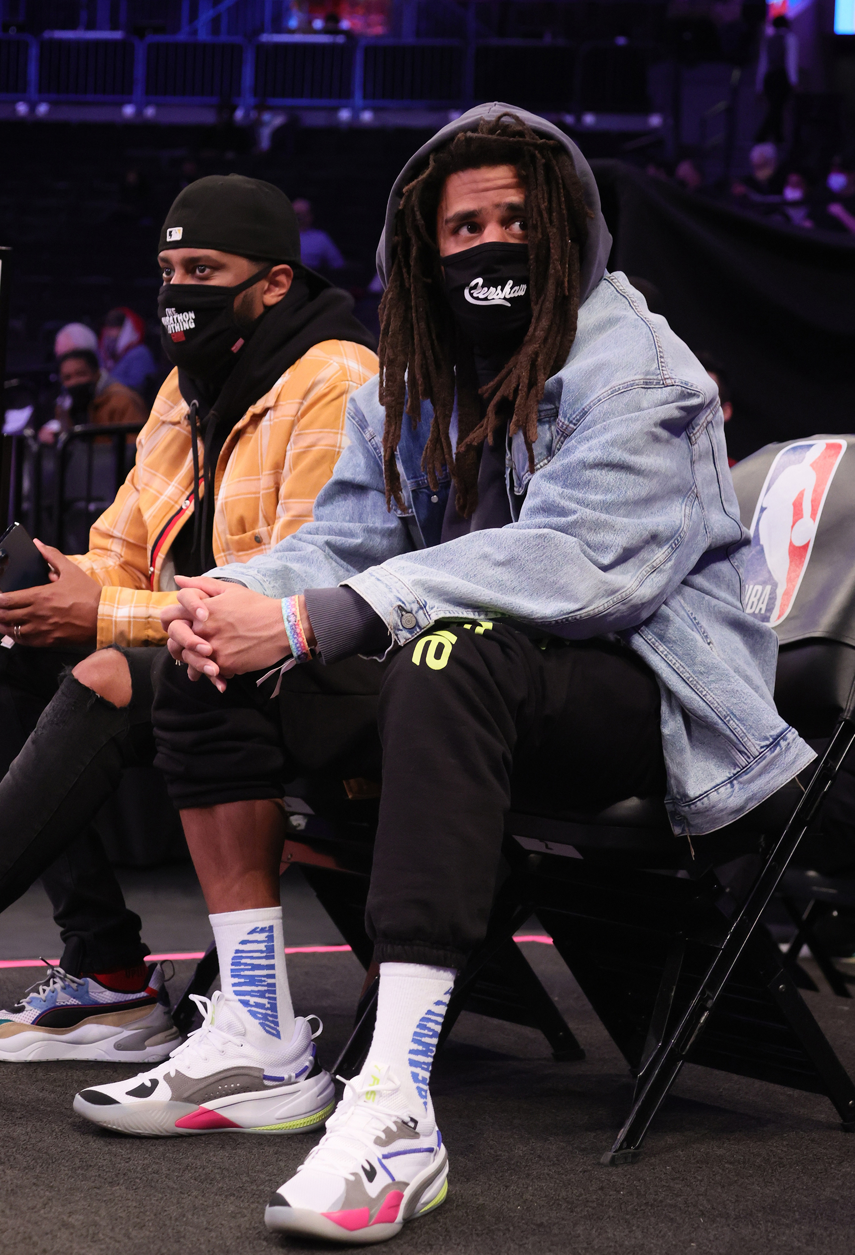 J. Cole Wears RS-Dreamer to Nets-Hornets Game