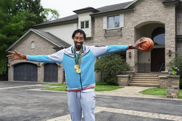 Pippen in front of his home